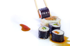 Sushi Japanese dishes. Sushi is a Japanese food consisting of cooked vinegared rice combined with other ingredients, seafood, vegetables and sometimes tropical Stock Images