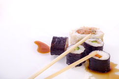 Sushi Japanese dishes. Sushi is a Japanese food consisting of cooked vinegared rice combined with other ingredients, seafood, vegetables and sometimes tropical Royalty Free Stock Images
