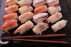 Sushi japanese food black slate platter wood chopsticks. Sushi japanese food black slate platter chopsticks Stock Photo