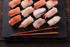 Sushi japanese food black slate platter chopsticks. Sushi japanese food selection black slate platter chopsticks Royalty Free Stock Photo
