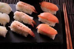 Sushi japanese food platter chopsticks close up. Sushi japanese food platter chopsticks Stock Photo