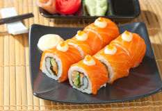 Roll salmon Sushi, Japanese food menu. Isolated on dish stock photos