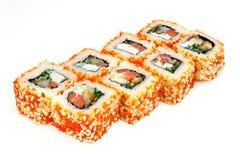 Sushi japonês do marisco, rolo em um fundo branco Foto de Stock