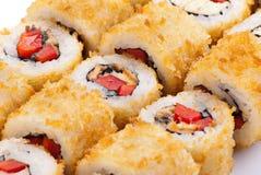 Sushi japonais de plan rapproché d'une plaque blanche. Positionnement de sushi Images stock
