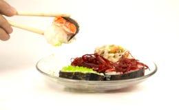 Sushi japonais sur un fond blanc Photographie stock