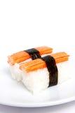Sushi Kani on the plate. Japanese sushi with Kani and Seaweed on white background royalty free stock image