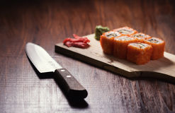 Sushi with knife. Japanese sushi on the desk with knife Stock Photo