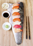 Sushi on Large Salmon Fillet serving as plate Stock Photography