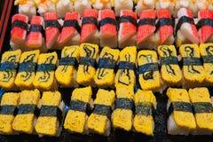 Sushi, loempia's Stock Afbeeldingen
