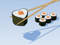 Sushi Love. Heart shaped sushi between chop sticks Stock Photos