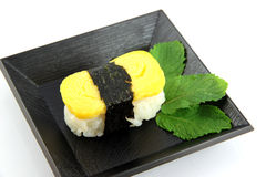 Sushi made from egg on dish. Stock Image
