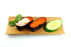 Sushi made ​​from seafood on a bamboo dish. Royalty Free Stock Photo
