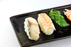 Sushi made ​​from seafood on Black dish. Stock Photo