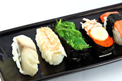Sushi made ​​from seafood on Black dish. Royalty Free Stock Images