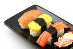 Sushi made ​​from seafood on Black dish. Stock Photos