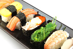 Sushi made ��from seafood on Black dish. Stock Photos