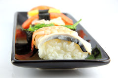 Sushi made from seafood on Black dish. Royalty Free Stock Photos