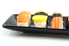 Sushi made from seafood on Black dish. Royalty Free Stock Image