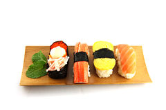 Sushi made ​​from seafood on the white background. Royalty Free Stock Photos