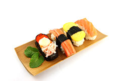 Sushi made ​​from seafood on the white background. Royalty Free Stock Image