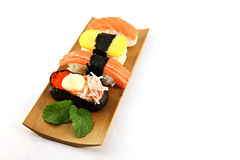 Sushi made ​​from seafood on the white background. Stock Photography