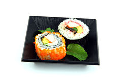 Sushi made ​​from seafood on a white background. Royalty Free Stock Photography