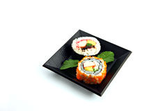 Sushi made ​​from seafood on a white background. Stock Images