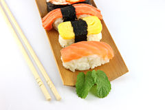 Sushi made from Tuna fish on a bamboo dish and Chopsticks Stock Image
