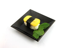 Sushi made from egg on dish. Royalty Free Stock Image