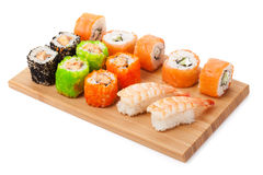 Sushi maki. On bamboo board. Isolated on white background stock photography