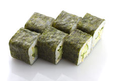 Sushi maki with cucumber and sesame isolated Royalty Free Stock Photos