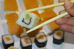 Sushi, maki in detail with sticks stock photography