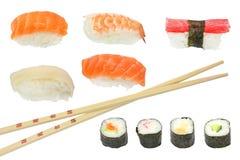 Sushi and maki mixed. With chopsticks isolated on white background stock image