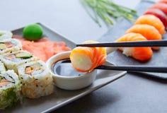 Sushi Maki and Niguiri soy sauce and wasabi Royalty Free Stock Image