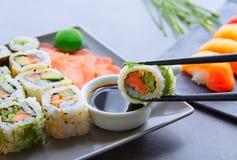 Sushi Maki and Niguiri soy sauce and wasabi Stock Photos