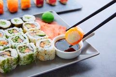 Sushi Maki and Niguiri soy sauce and wasabi Royalty Free Stock Photos