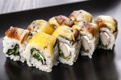 Sushi. Maki roll assortment on black dish stock images
