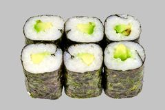 Sushi maki roll with avocado on a gray background. Japanese food diet food rice fish delicious restaurant traditional fresh asia asian delicacy healthy raw menu stock images