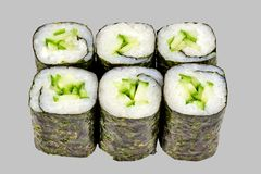 Sushi maki roll with cucumber on a gray background. Japanese food diet food rice fish delicious restaurant traditional fresh asia asian delicacy healthy raw stock photo