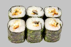 Sushi maki roll with eel on a gray background. Japanese food diet food rice unagi sauce sesame fish delicious restaurant traditional fresh asia asian delicacy royalty free stock photos