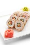 Sushi. Maki Sushi -  Roll made of Cucumber, Bell Pepper, Lettuce inside. Bacon outside Stock Photo