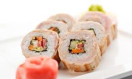 Sushi. Maki Sushi -  Roll made of Cucumber, Bell Pepper, Lettuce inside. Bacon outside Stock Image