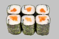 Sushi maki roll with salmon on a gray background. Japanese food diet food rice fish delicious restaurant traditional fresh asia asian delicacy healthy raw menu stock photo