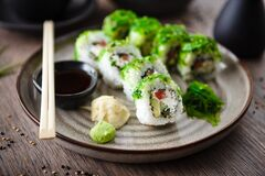 Free Sushi Maki Rolls With Cucumber, Avocado, Tomato, Creamy Cheese, Chuka Wakame On A Plate With Chopsticks, Soy Sauce Stock Image - 200219721