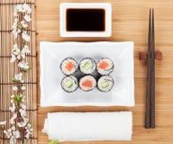Sushi maki set with fresh sakura branch Royalty Free Stock Images