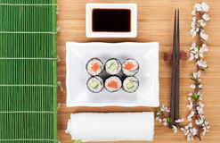Sushi maki set with fresh sakura branch Stock Photo