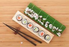 Sushi maki set with fresh sakura branch Royalty Free Stock Photography