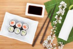 Sushi maki set with fresh sakura branch Royalty Free Stock Photo