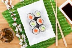 Sushi maki set, green tea and sakura branch Stock Images