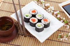 Sushi maki set, green tea and sakura branch Stock Photos